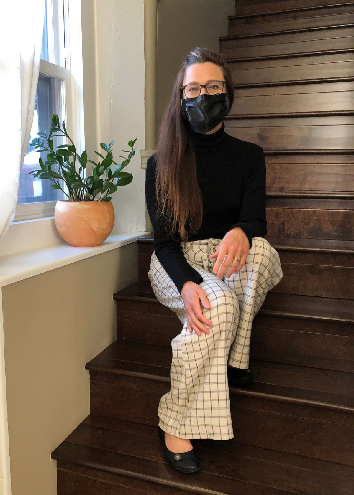 Jessica's Apothecary owner wearing a satin face mask to teach how to treat maskne