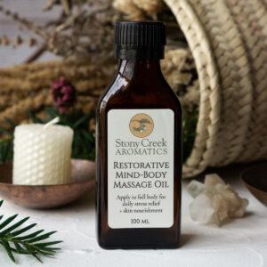 A bottle of Stony Creek Aromatics Restorative Mind-Body Massage Oil