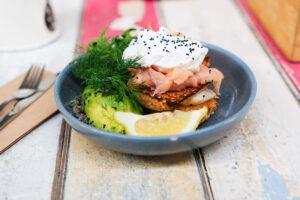 An omegga-rich meal including salmon, eggs, and avocado